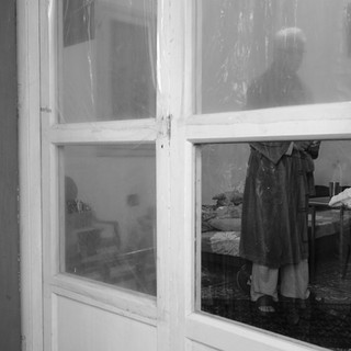 Saïd behind his broken windows