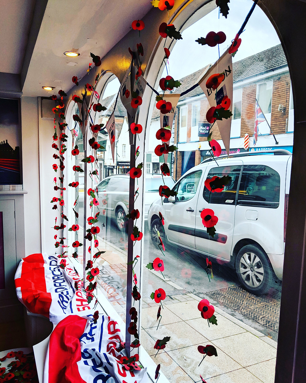 Remembrance Day window display at Peeli Ltd, Smith Street, Warwick. Custom prints and graphics.