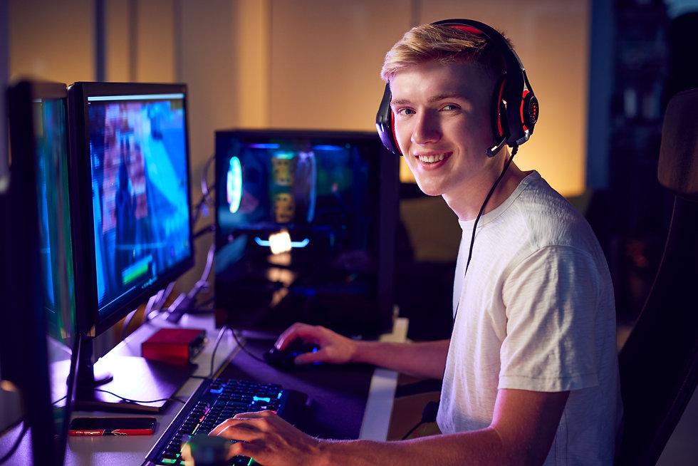 portrait-of-teenage-boy-wearing-headset-