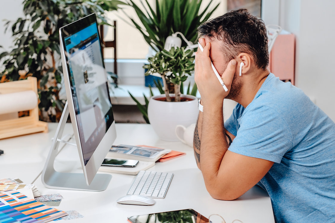 overworked-office-worker-sits-at-table-at-his-work-MP3R679.jpg