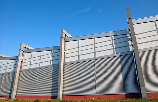 modern-facade-of-an-industrial-building-P7FYYVE.jpg