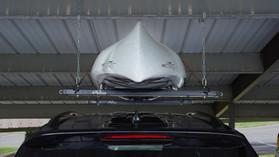 Black Roo Rack - Single in carport holding kayak