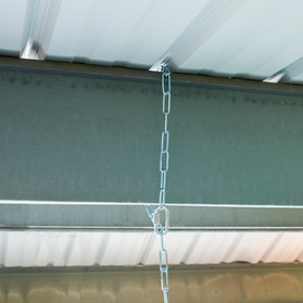 Hanging chain under corrugated carport roof