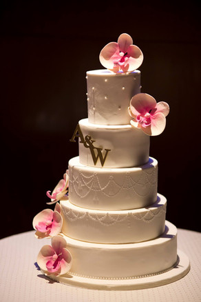 Orchid themed 5 tiered wedding cake