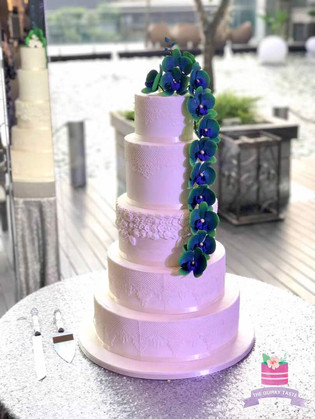 Peacock themed 5 tier wedding cake