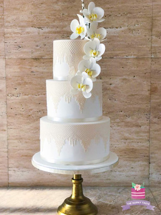 Flowing orchid 3 tier wedding cake