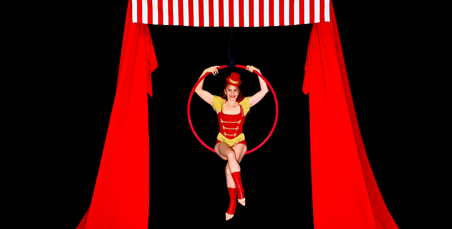 CIRCUS THEMED FREESTANDING AERIAL RIG WITH HOOP - Dressed with a classic vintage circus look. Ideal for The Greatest Show and circus themed events.
