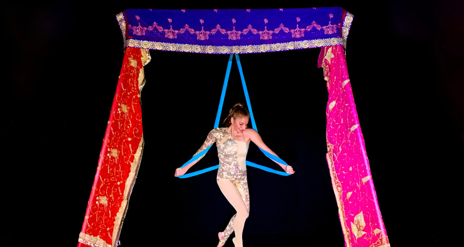 INDIAN THEMED FREESTANDING AERIAL RIG WITH SLING - Dressed with stunning Indian silk. A beautiful option for Indian weddings, Indian Summer, Bollywood, Arabian nights or any exotic themed events.