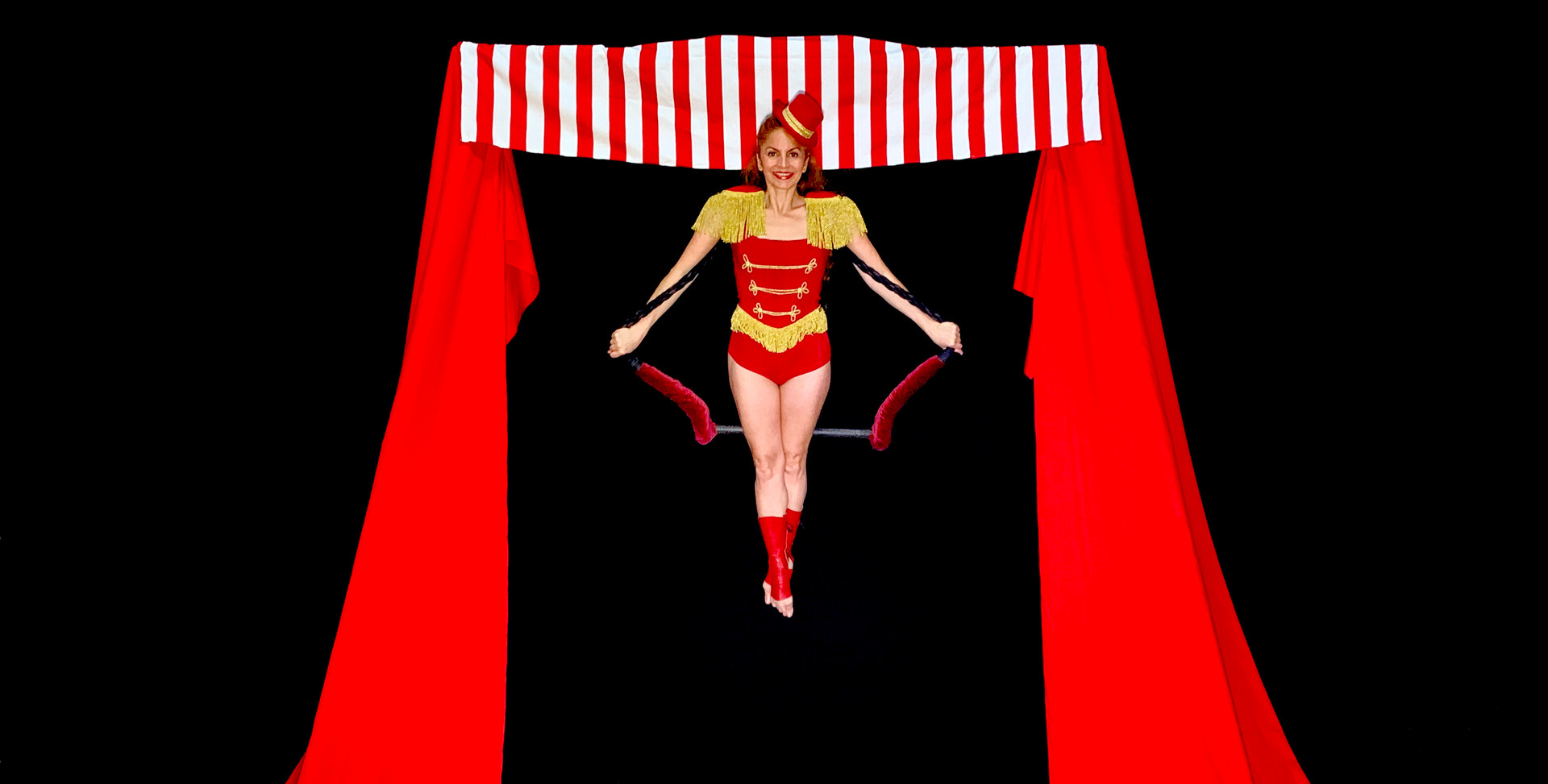 CIRCUS THEMED FREESTANDING AERIAL RIG WITH TRAPEZE - Dressed with a classic vintage circus look.  Ideal for The Greatest Show and circus themed events.