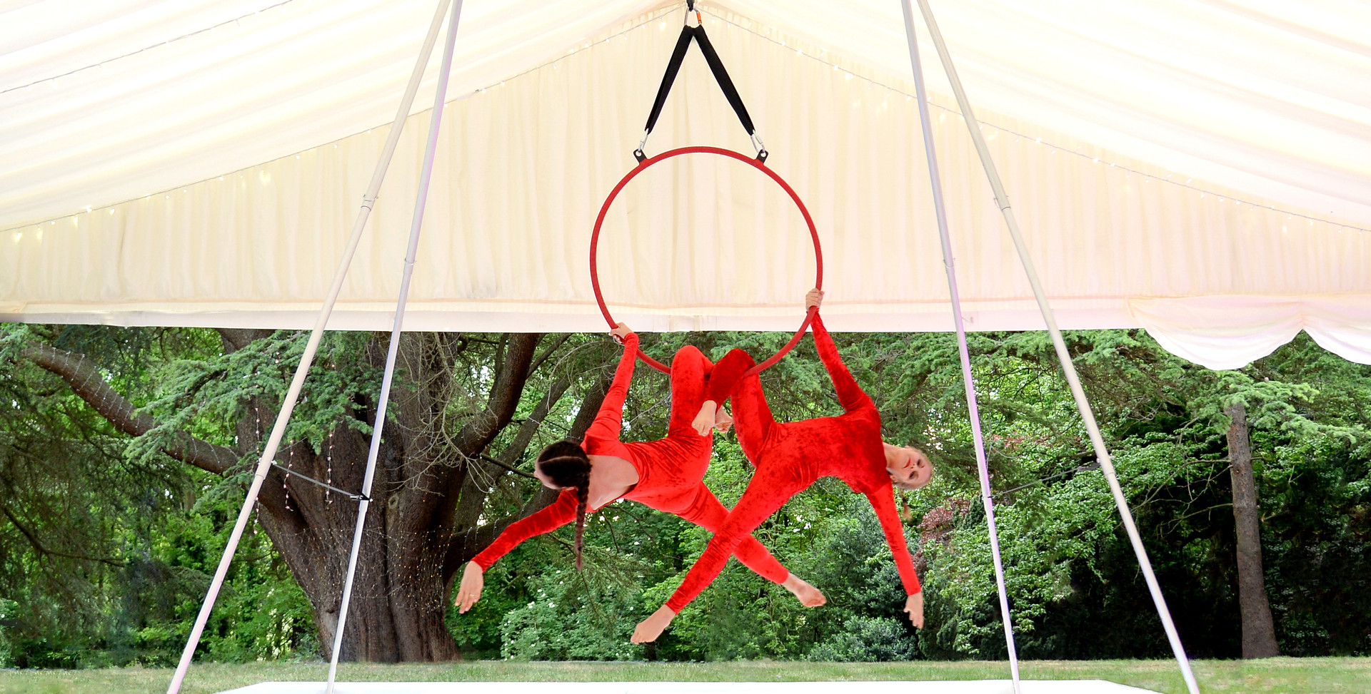 HOOP DOUBLES ON AERIAL FREESTANDING RIG - Duo aerial hoop performance on portable aerial rig with no themed dressing. Entertainment at a Bat Mitzvah in a marquee at a beautiful outdoor venue