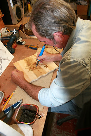 Olly creating a Pyrography plaque