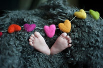 Canva - Baby's Feet Covered With Black W