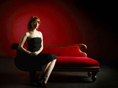 WOMAN ON RED CHAISE LOUNGE