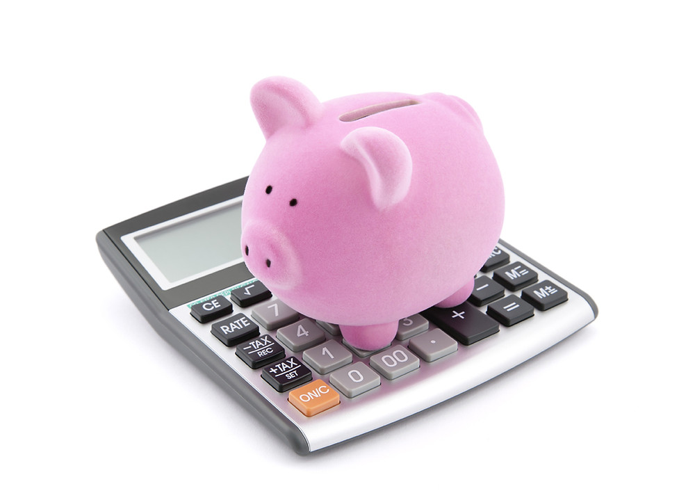 Calculator; piggy bank; budget