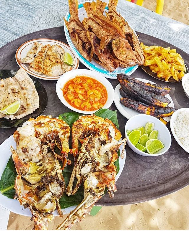 Fresh fish and lobster served at the beach