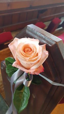 Simple rose pew ends
