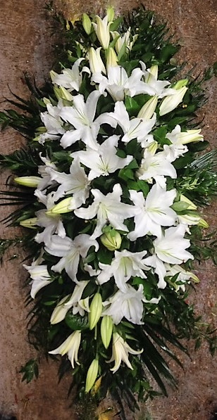 Pure white lillies casket
