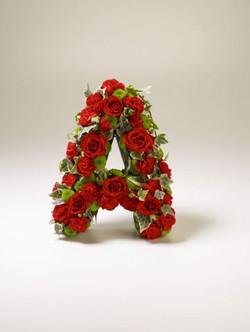 Funeral loose roses design lettering