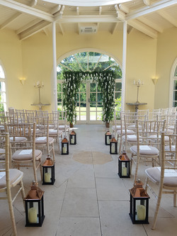 Waterfall arch and aisle lanterns