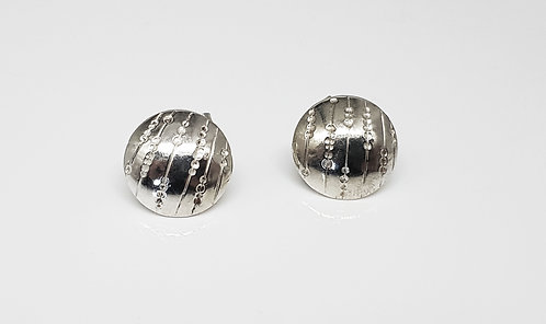 chasing and repousse, earring ,silver, texture, lines and dots, cardiff, silversmith, cardiff jeweller, silversmiths cardiff