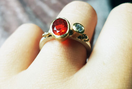 Rebecca Oldfield Fire Opal Bespoke Engagement Ring On The Finger