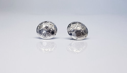 chasing and repousse, earrings,silver, texture, lunar circles, cardiff, silversmith, cardiff jeweller, silversmiths cardiff