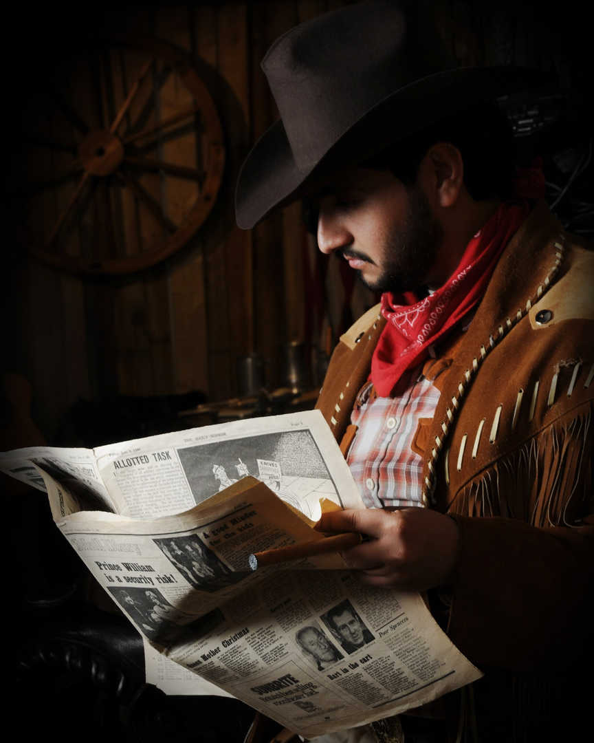 cowboy reading newspaper.jpg