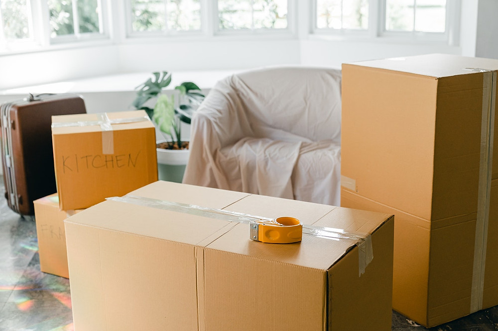 Moving Boxes. The Habitat Company, full service real estate firm.