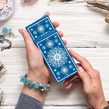 Fortune teller woman and a blue tarot ca