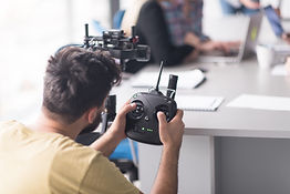 storyblocks-young-videographer-with-gimball-video-slr-at-work_HdgAPnsAoW-SBI-322505225.jpg