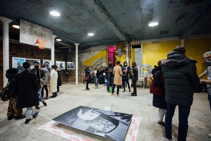Phase IV: art exhibition at Gymnopedie, Brooklyn with Conrad Clifton's print 'RISE' in the foreground