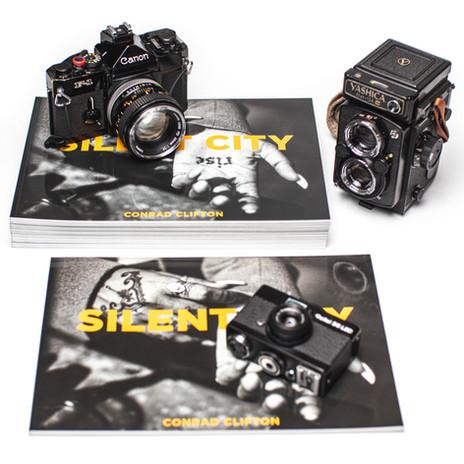 Conrad Clifton's photo book and cameras