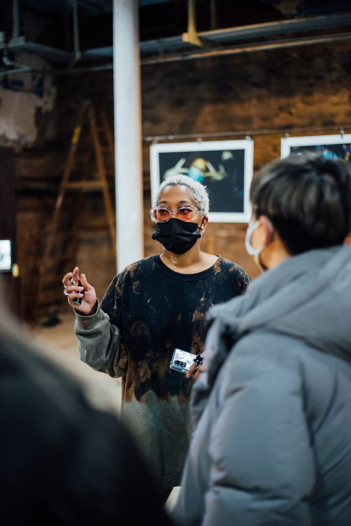 Artist Austance Caroline at Phase IV art exhibition at Gymnopedie, Brooklyn