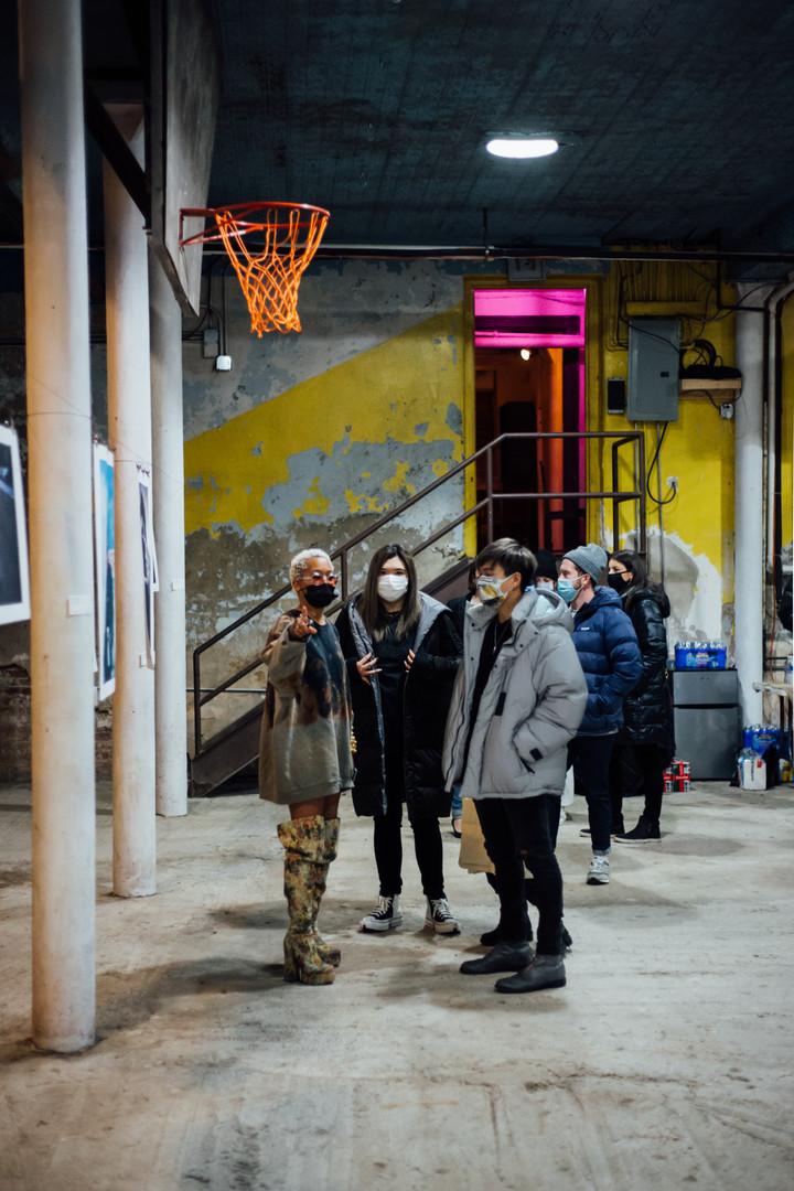 Conversing with artist Austance Caroline at Phase IV art exhibition
