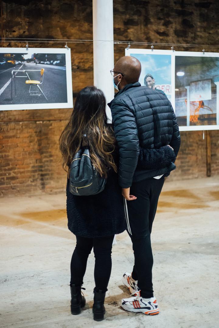 Contemplating Conrad Clifton's photos at Phase IV art exhibition