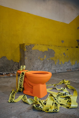 Orange toilet with caution tape (2020)
