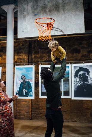 Enjoying Conrad Clifton's photos at Phase IV art exhibition