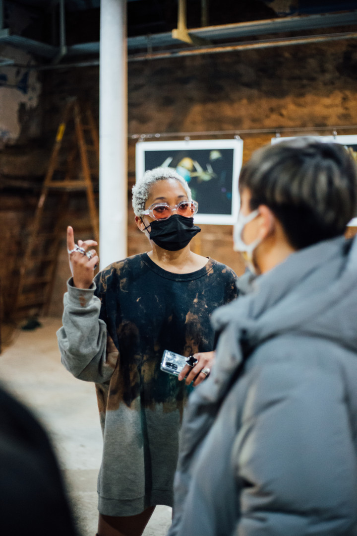 Artist Austance Caroline at Phase IV art exhibition