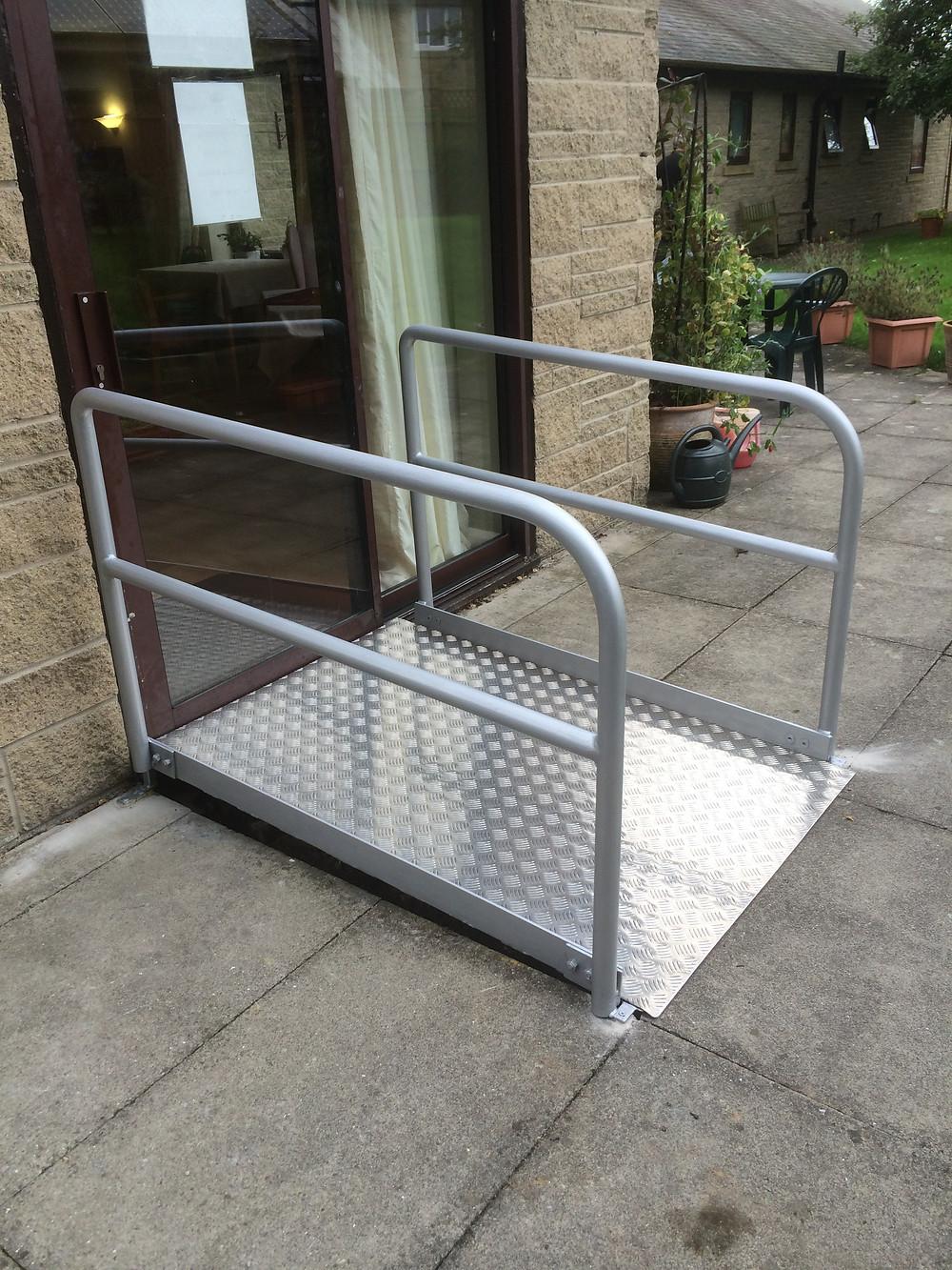Wheel chair ramp with handrails
