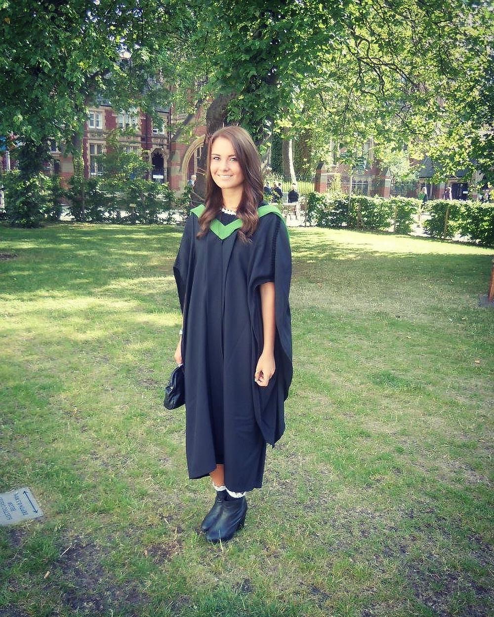 Lauren in a graduation gown.