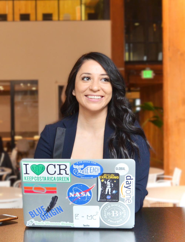 Lorena sat at her laptop smiling.