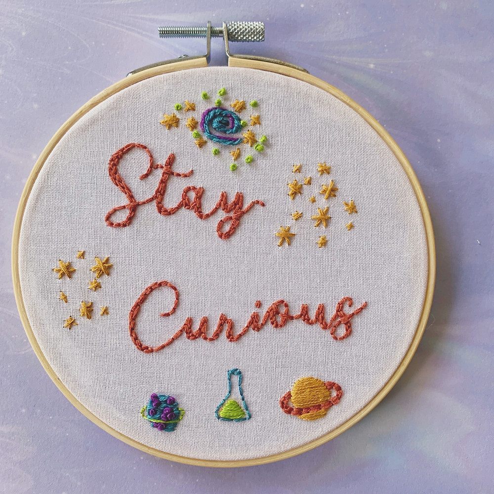 Photo of Lauren's 'Stay Curious' embroidery hoop.