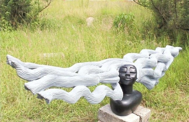 """""""A Windy Day"""" Springstone Scupture"""