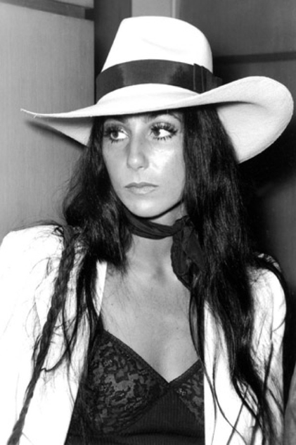 False eyelashes, tons of mascara, and a good hair straightener hair help create Cher's goddess looks.