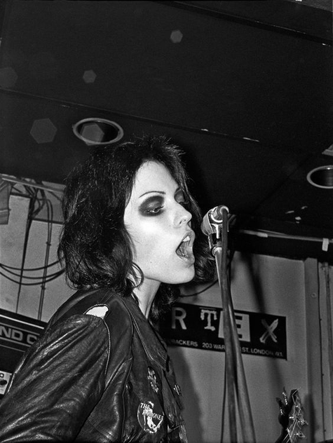 Steal Joan Jett's punk look with dark and moody eyeshadow and messy black hair.
