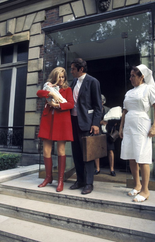 Roger Vadim and Jane Fonda leaving the hospital after the birth of their daughter, Vanessa, 1968