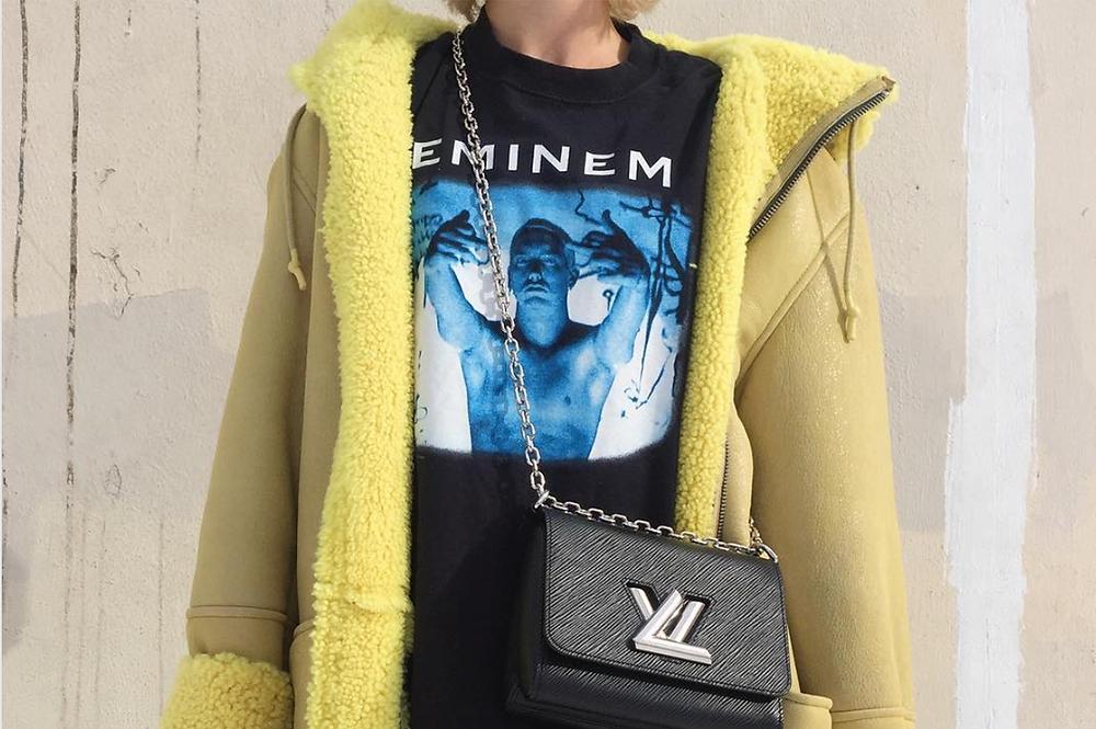 @esmolin on Instagram wears Eminem t-shirt and Louis Vuitton handbag.