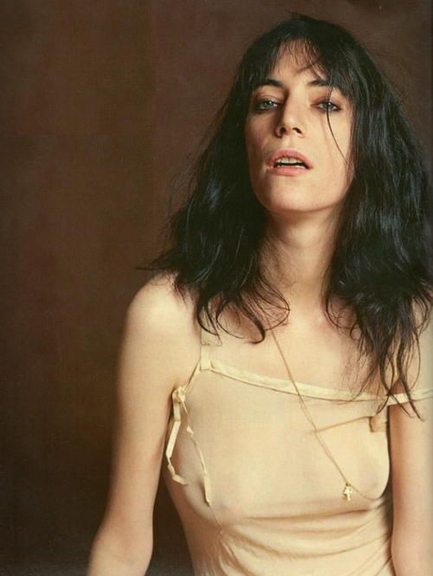 Thick eyeliner and tousled, self cut hair is all one needs to achieve Patti Smith's rock star look.