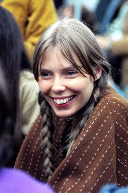 Can you say bohemian beauty? Take inspiration from Joni Mitchell's long braids and grown-out bangs for a soft summer look.