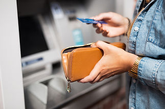 woman-withdrawing-money-from-atm-WUPTDCP
